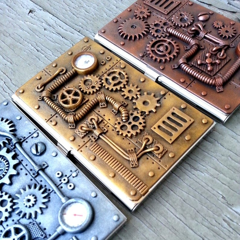 three business card holders