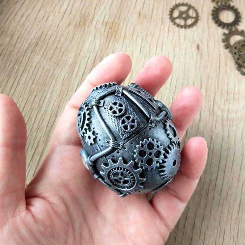 steampunk egg in hand